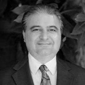 Black and white headshot of Amir Kalali, MD