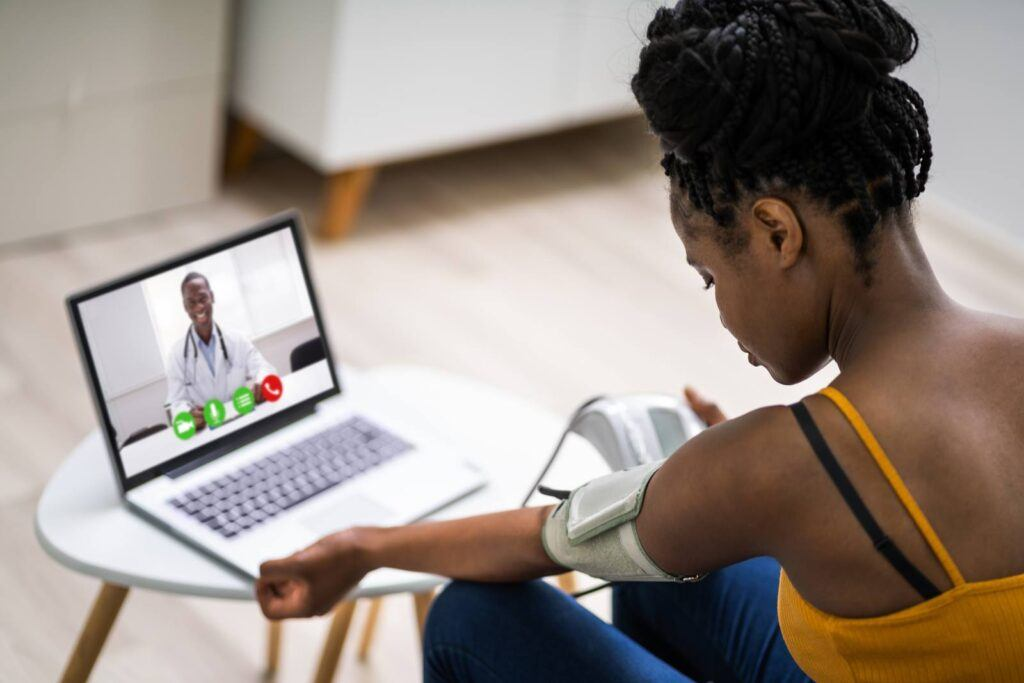 Online,Videoconference,On,Laptop,With,African,Doctor